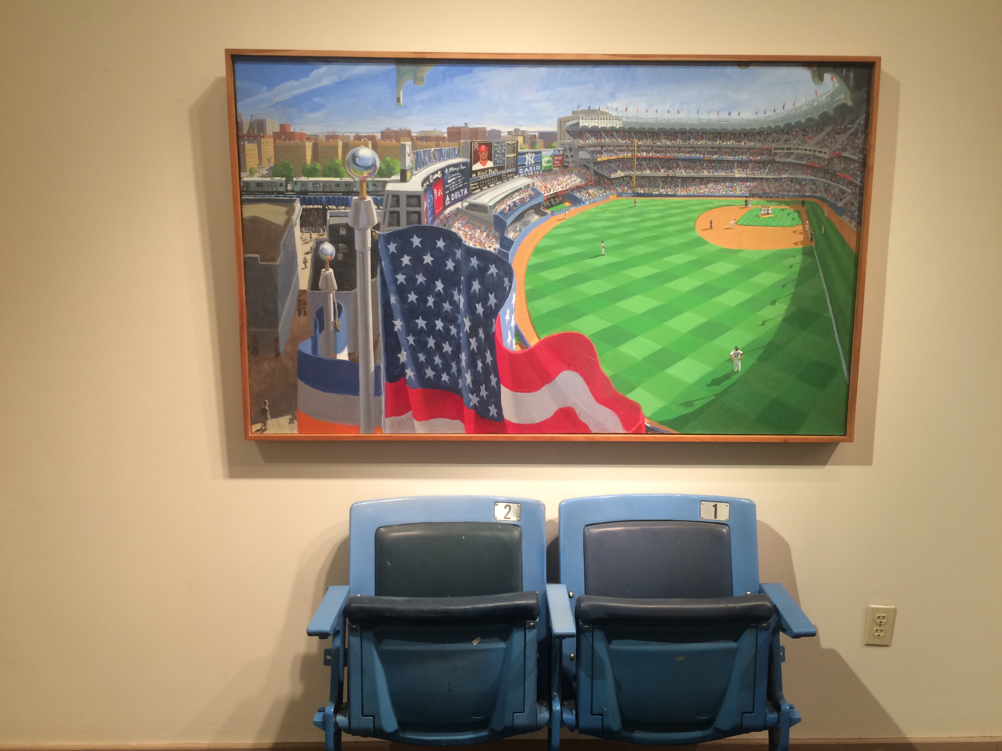 Mason's perspective on Yankee Stadium, featuring two stadium chairs at the base of his painting in the Landau Gallery.